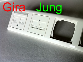 A Gira and a Jung wallmount in a Gira Plastic Cover (Pure white glossy)